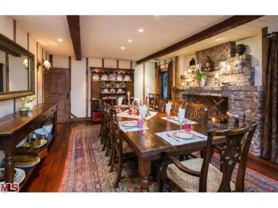 Kind of Hobbit-like dining room, with fireplace. All photos via Trulia Luxe/MLS