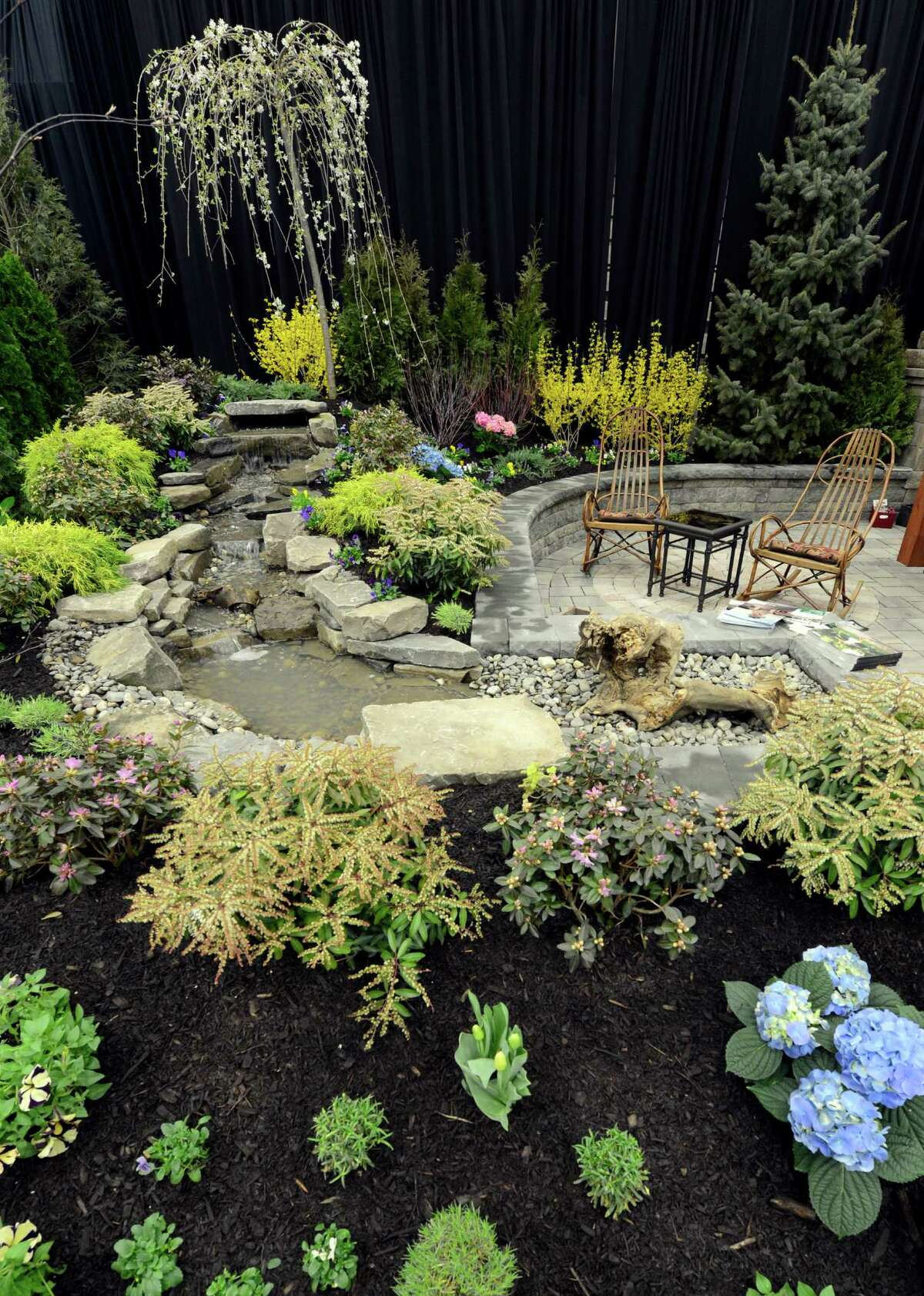 One of the floral and water displays March 22, 2013, this one designed by Decker Landscaping at the Capital District Garden & Flower Show at the McDonough Sport Complex in Troy, N.Y. The show continues through Sunday. (Skip Dickstein/Times Union)