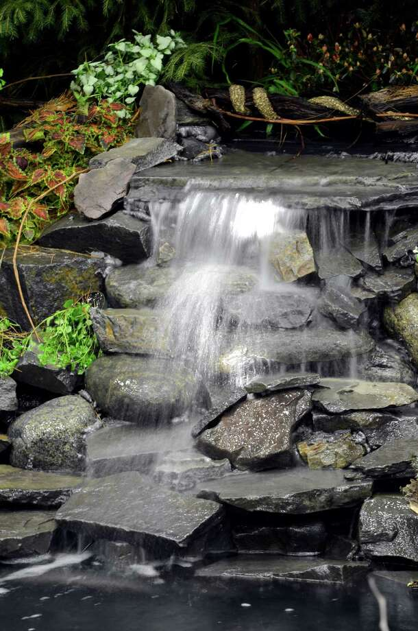 One of the many water displays March 22, 2013,  this one designed by Decker Landscaping at the Capital District Garden & Flower Show at the McDonough Sport Complex in Troy, N.Y.  The show continues through Sunday.  (Skip Dickstein/Times Union) Photo: SKIP DICKSTEIN, ALBANY TIMES UNION / 10021625A