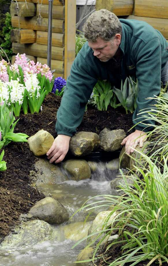 David Orsini of Orsini Landscaping works on his water display March 22, 2013, at the Capital District Garden & Flower Show at the McDonough Sport Complex in Troy, N.Y.  The show continues through Sunday.  (Skip Dickstein/Times Union) Photo: SKIP DICKSTEIN, ALBANY TIMES UNION / 10021625A