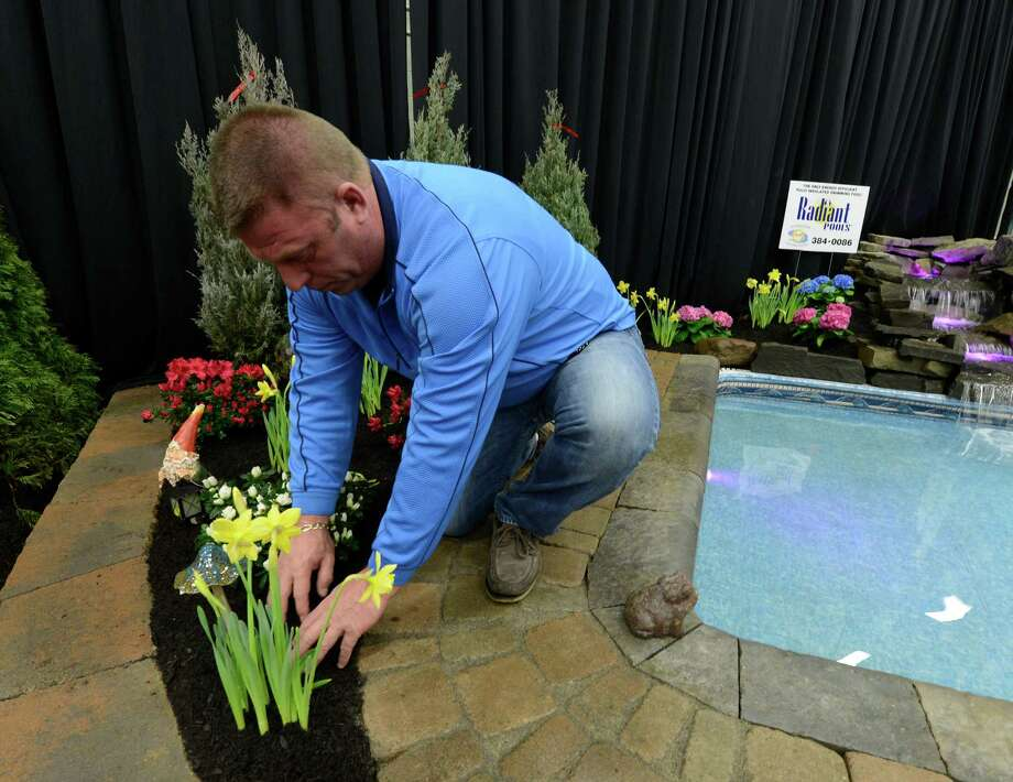 Rich Mollnow of Sunshine Landscaping works on his display March 22, 2013,  at the Capital District Garden & Flower Show at the McDonough Sport Complex in Troy, N.Y.  The show continues through Sunday.  (Skip Dickstein/Times Union) Photo: SKIP DICKSTEIN, ALBANY TIMES UNION / 10021625A