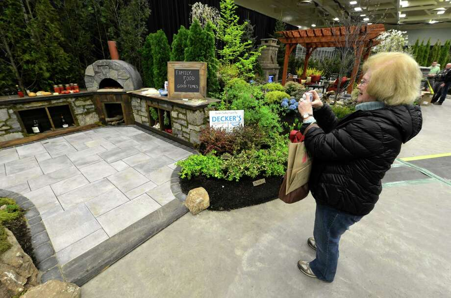 Chris Boken of Stanford photographs one of the largest floral March 22, 2013,  this one designed by Decker Landscaping at the Capital District Garden & Flower Show at the McDonough Sport Complex in Troy, N.Y.  The show continues through Sunday.  (Skip Dickstein/Times Union) Photo: SKIP DICKSTEIN, ALBANY TIMES UNION / 10021625A