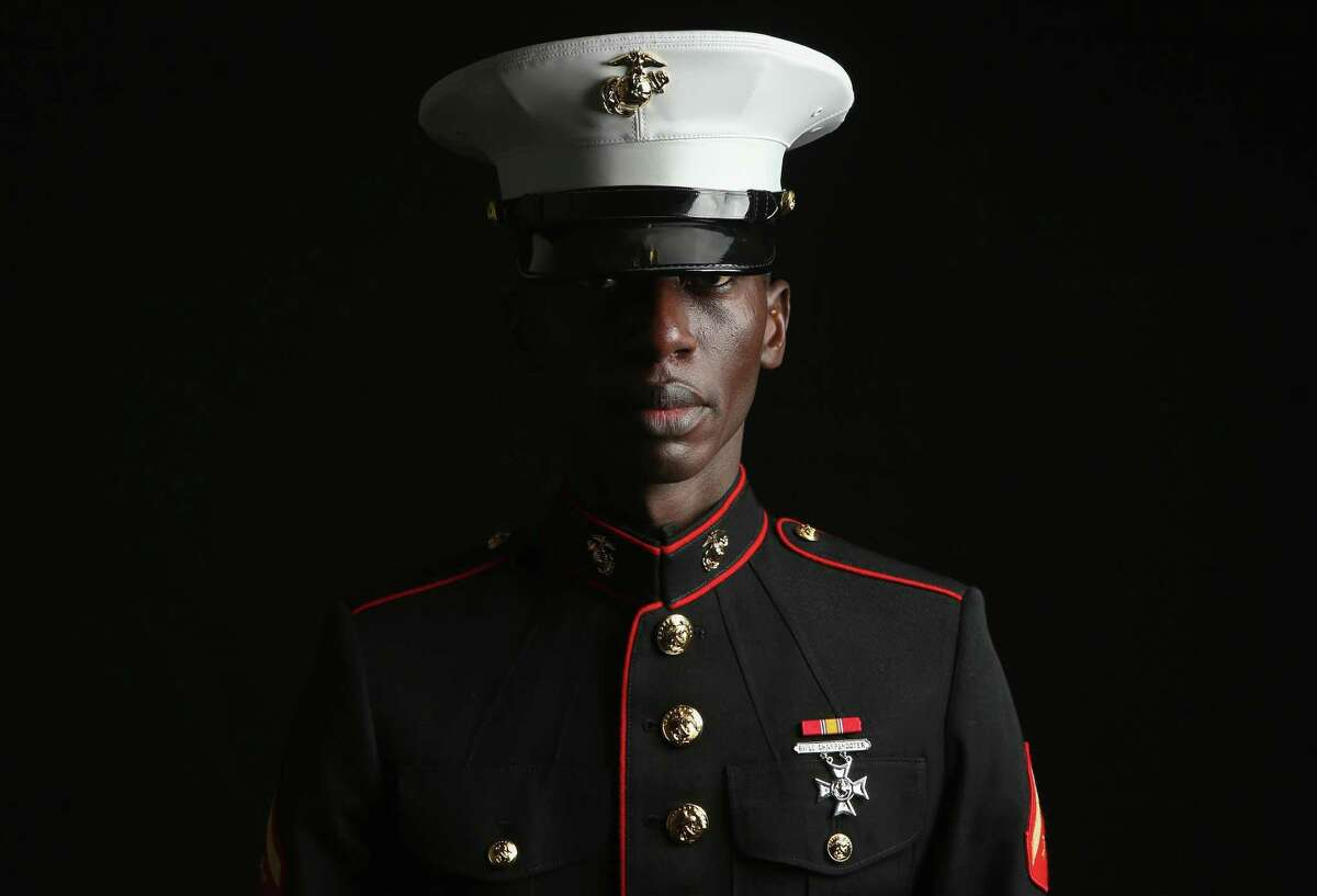 NEW YORK, NY - MARCH 22: U.S. Marine LCP. Torffic Hassan, 26, an immigrant from Ghana, stands for a portrait before being naturalized as an American Citizen on March 22, 2013 in New York City. A Marine reservist, he is a nursing student living in the Bronx borough of New York City. Some 680,000 immigrants become U.S. citizens each year at naturalization ceremonies held by the U.S. Citizenship and Immigration Services (USCIS). One of the general requirements of the Immigration and Nationality Act states that immigrants must be legal residents of the United States, holding a green card, before they can become American citizens. Any immigration reform will have to take into account the estimated 11 million immigrants living in the U.S. without legal documents.