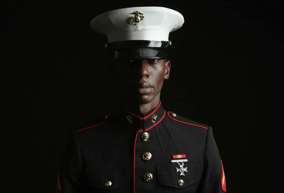 NEW YORK, NY - MARCH 22:  U.S. Marine LCP. Torffic Hassan, 26, an immigrant from Ghana, stands for a portrait before being naturalized as an American Citizen on March 22, 2013 in New York City. A Marine reservist, he is a nursing student living in the Bronx borough of New York City. Some 680,000 immigrants become U.S. citizens each year at naturalization ceremonies held by the U.S. Citizenship and Immigration Services (USCIS). One of the general requirements of the Immigration and Nationality Act states that immigrants must be legal residents of the United States, holding a green card, before they can become American citizens. Any immigration reform will have to take into account the estimated 11 million immigrants living in the U.S. without legal documents. Photo: John Moore, Getty Images / 2013 Getty Images