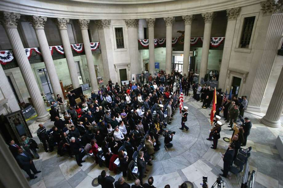 NEW YORK, NY - MARCH 22:  Immigrants attend a naturalization ceremony to become American citizens at Federal Hall on March 22, 2013 in New York City. Seventy-four immigrants from 39 different countries took part in the event held in the historic building where George Washington took the oath of office as the first President of the United States. The event was held by U.S. Immigrant and Citizenship Services (USCIS). Photo: John Moore, Getty Images / 2013 Getty Images