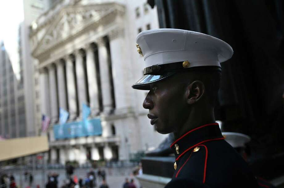 NEW YORK, NY - MARCH 22:  U.S. Marine Lance Cpl. Torffic Hassan from Ghana looks on to Wall Street after becoming a U.S. citizen at a naturalization ceremony at Federal Hall on March 22, 2013 in New York City. Seventy-four immigrants from 39 different countries took part in the event held in the historic building where George Washington took the oath of office as the first President of the United States. The event was held by U.S. Immigrant and Citizenship Services (USCIS). Photo: John Moore, Getty Images / 2013 Getty Images
