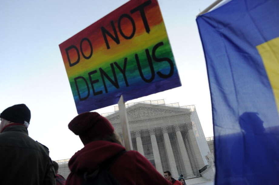 Supporters of same-sex marriage gather in front of the US Supreme Court on March 26, 2013 in Washington, DC. Same-sex marriage takes center stage at the US Supreme Court on Tuesday as the justices begin hearing oral arguments on the emotionally-charged issue that has split the nation. AFP PHOTO/Jewel Samad Photo: JEWEL SAMAD, AFP/Getty Images / 2013 AFP