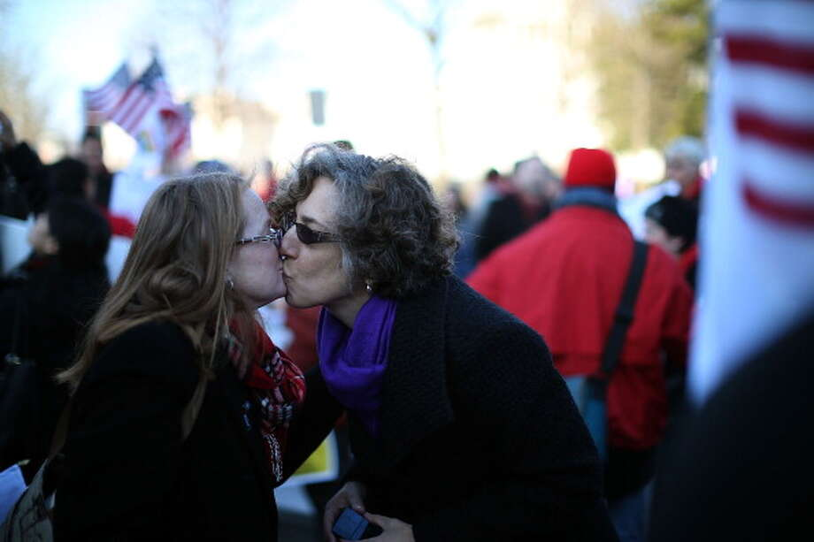 WASHINGTON, DC - MARCH 26: Andrea Grill (R) and Lee Ann Hopkins (L), from Alexandria VA. kiss after becoming engaged during a rally outside of the U.S Supreme Court, on March 26, 2013 in Washington, DC. Today the high court is scheduled to hear arguments in California's proposition 8, the controversial ballot initiative that defines marriage as between a man and a woman. Photo: Mark Wilson, Getty Images / 2013 Getty Images