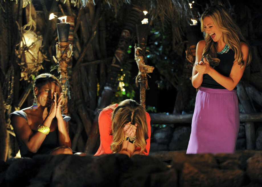 In this photo provided by CBS Entertainment, Survivor: One World contestants Kim Spradlin, center, Chelsea Meissner, right, and Sabrina Thompson react after Spradlin is crowned sole survivor during the live reunion show in New York, Sunday, May 13, 2012. (AP Photo/CBS Entertainment, Jeffrey R. Staab) MANDATORY CREDIT Photo: AP