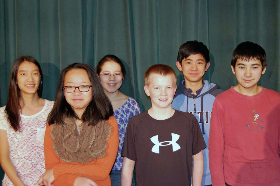 The Darien students who participated in the annual String Festival are, in front row from left, Wen Yan Toh, Talmage Lindsey and John Selkowitz. Back row, Candice Wang, Sara Baldwin and Ben Zhao. Photo: Contributed