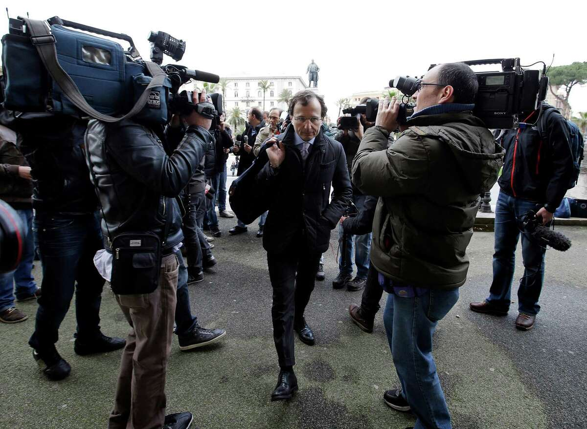 Francesco Maresca, lawyer of Meredith Kercher's relatives, center, arrives at Italy's Court of Cassation, in Rome, Tuesday, March 26, 2013. Italy's highest criminal court has overturned the acquittal of Amanda Knox in the slaying of her British roommate and ordered a new trial.