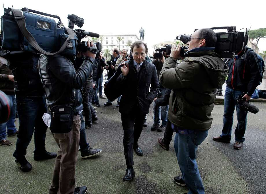 Francesco Maresca, lawyer of Meredith Kercher's relatives, center, arrives at Italy's Court of Cassation, in Rome, Tuesday, March 26, 2013. Italy's highest criminal court has overturned the acquittal of Amanda Knox in the slaying of her British roommate and ordered a new trial. Photo: Ap
