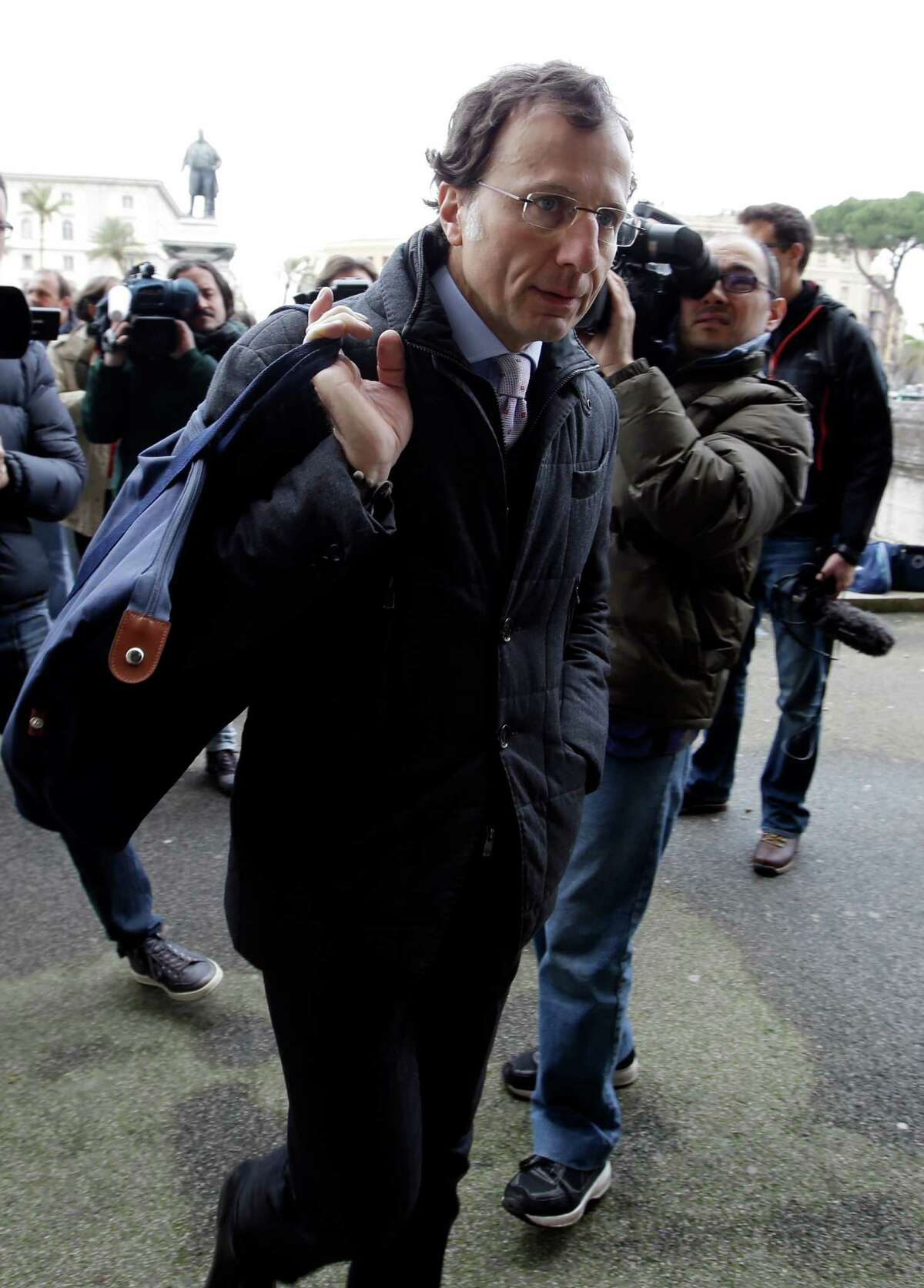 Francesco Maresca, lawyer of Meredith Kercher's relatives, center, arrives at Italy's Court of Cassation, in Rome, Tuesday.