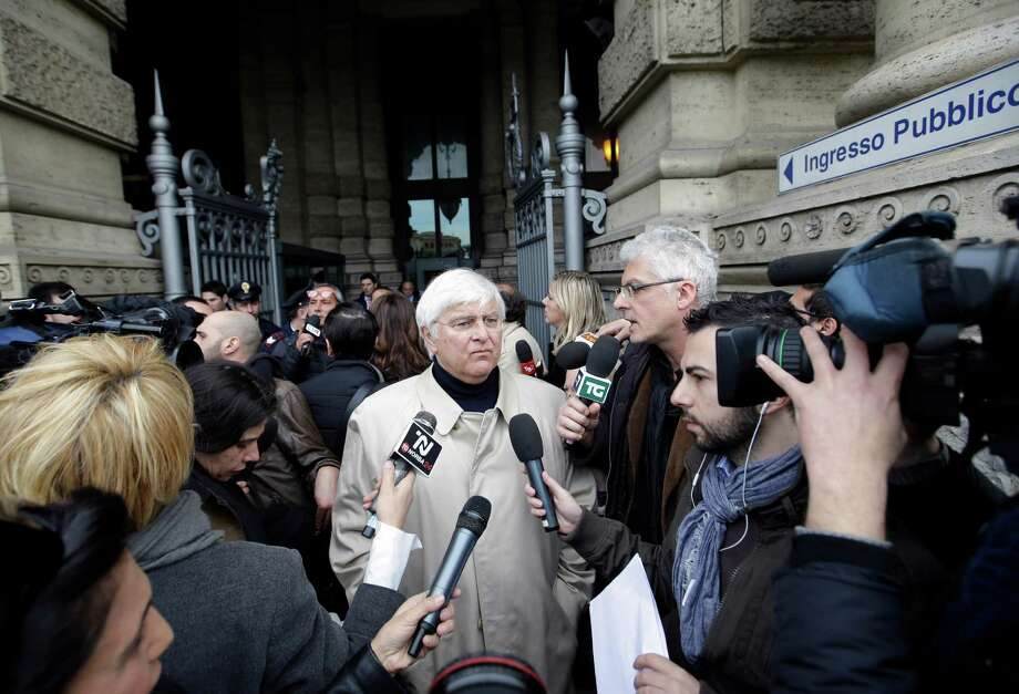 Luciano Ghirga, lawyer of Amanda Knox, center, talks to journalists as he leaves Italy's Court of Cassation, in Rome, Tuesday . Photo: Ap