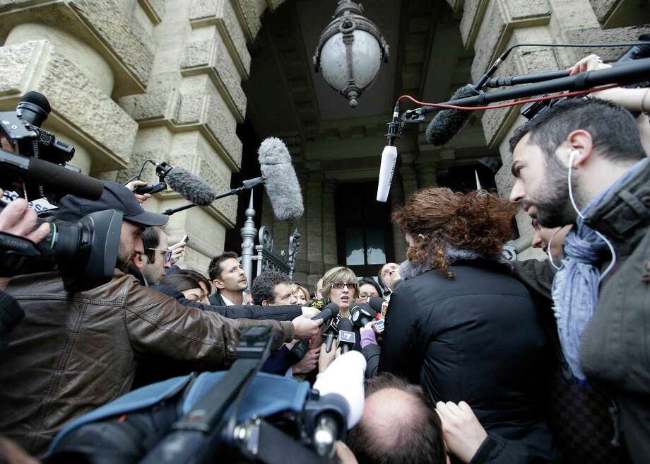Giulia Bongiorno, lawyer of Amanda Knox's ex-boyfriend, Raffaele Sollecito, center, talks to journalists as she leaves Italy's Court of Cassation, in Rome, Tuesday,, Photo: Ap