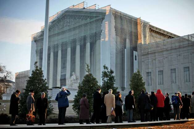People line up for entrance into the Supreme Court in Washington, Tuesday, March 26, 2013, where the court will hear arguments on California's voter approved ban on same-sex marriage, Proposition 8. Photo: Pablo Martinez Monsivais