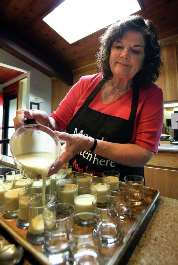 Marianne Anderson prepares individual banana custard desserts in her kitchen for a social gathering of neighbors, on Thursday, March 21, 2013. Photo: BOB OWEN, San Antonio Express-News / © 2012 San Antonio Express-News