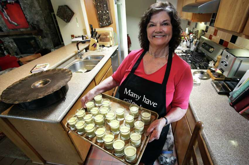 Marianne Anderson prepares individual banana custard desserts in her kitchen for a social gathering of neighbors. Read the recipe.