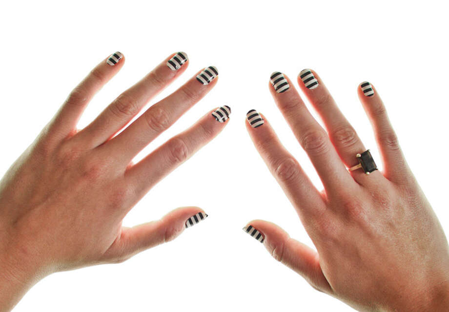 Nail wraps don't chip and should last for at least two weeks. To remove, heat with the hair dryer and peel off gently with tweezers. (Acetone might help remove the adhesive.)