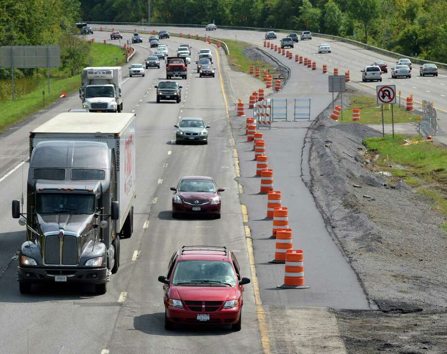 A temporary lane marked by orange cones north of the Twin Bridges  on I87 in Clifton Park Thursday Sept. 6, 2012 will merge diverted traffic after the bridge work. (John Carl D'Annibale / Times Union) Photo: John Carl D'Annibale / 00019163A