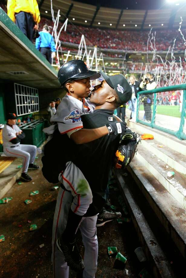 Shawon Dunston kisses his son Shawon Jr. after a game. Photo: Michael Macor, SFC / Chronicle