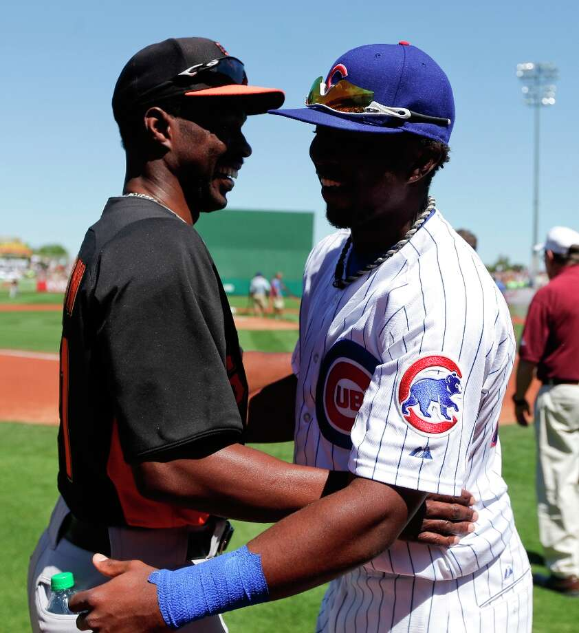 San Francisco Giants special assistant Shawon Dunston, left, hugs his son Shawon Jr., of the Chicago Cubs, before a spring training exhibition baseball game in Mesa, Ariz., Monday, March 25, 2013. Photo: Chris Carlson, Associated Press / AP