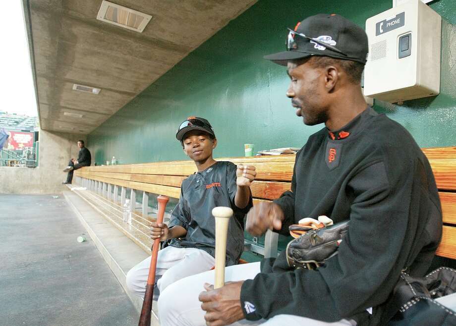 Shawon Dunston, along with his 9-year-old son Shawon Jr., in the dugout at the end of San Francisco's final workout before the start of the 2002 World Series Photo: MICHAEL MACOR, SFC / CHRONICLE