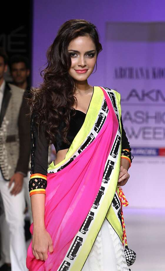A little more bland aloofness, please:You can tell that Bollywood actress Shazahn Padamsee, showing a creation by designer Archana Kochhar during Lakme Fashion Week, isn't a real model because she's smiling. Photo: Stringer, AFP/Getty Images