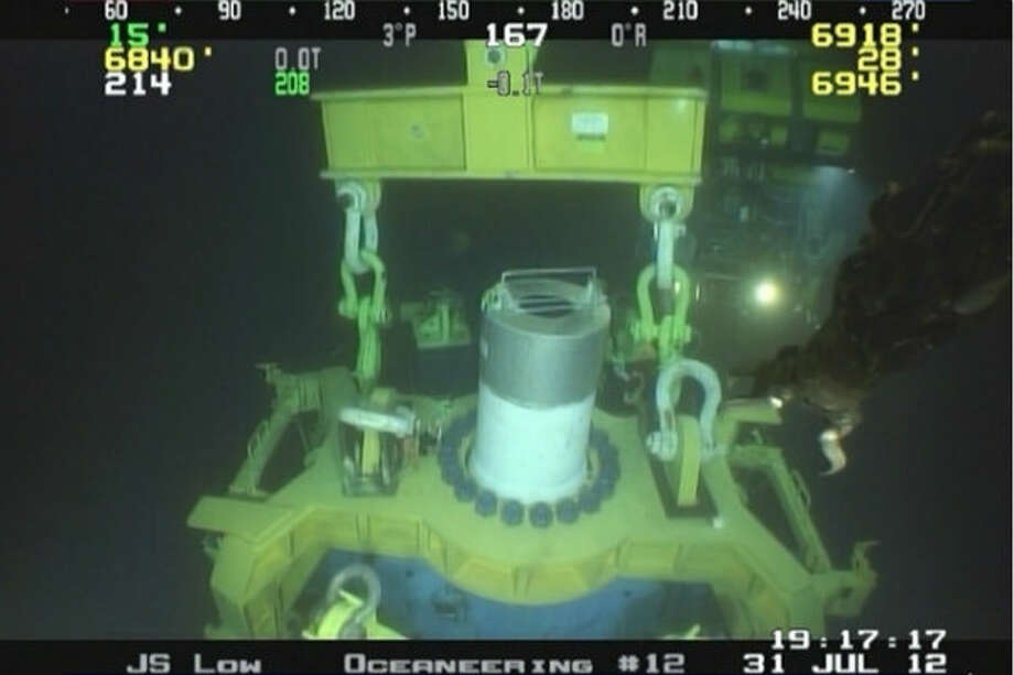 Once the simulated well was successfully shut in, the MWCC capping stack was prepared for retrieval. A spreader bar was attached and used to raise the capping stack back onto the Laney Chouest.