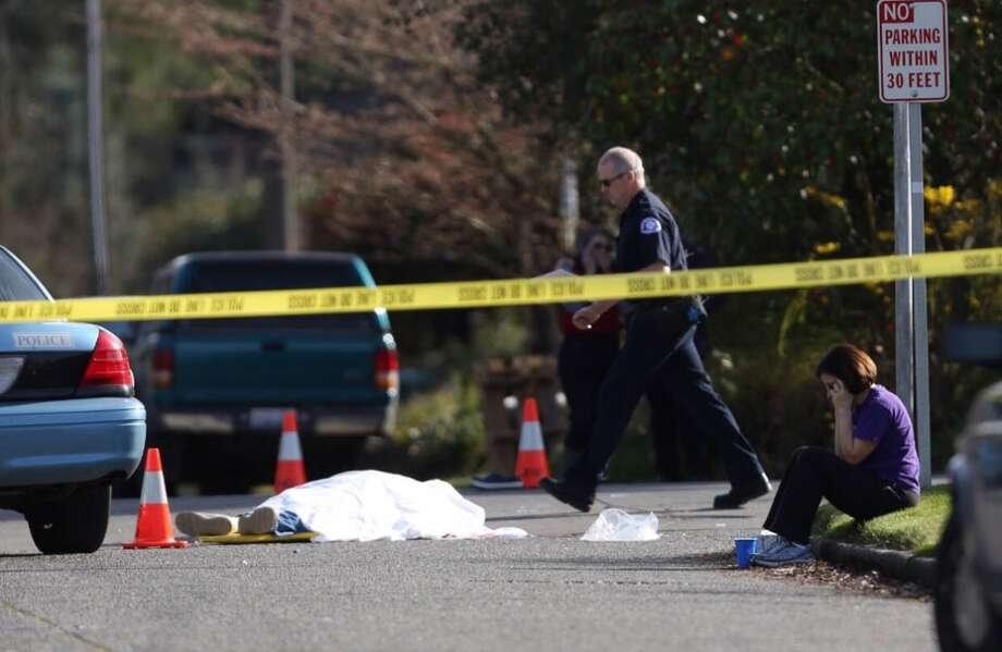 The scene is shown after a man suspected of DUI hit a family on 75th Avenue NE on Monday, March 26, 2013 in Seattle, killing two and critically injuring a woman and 10 day-old infant. (Joshua Trujillo, seattlepi.com)
