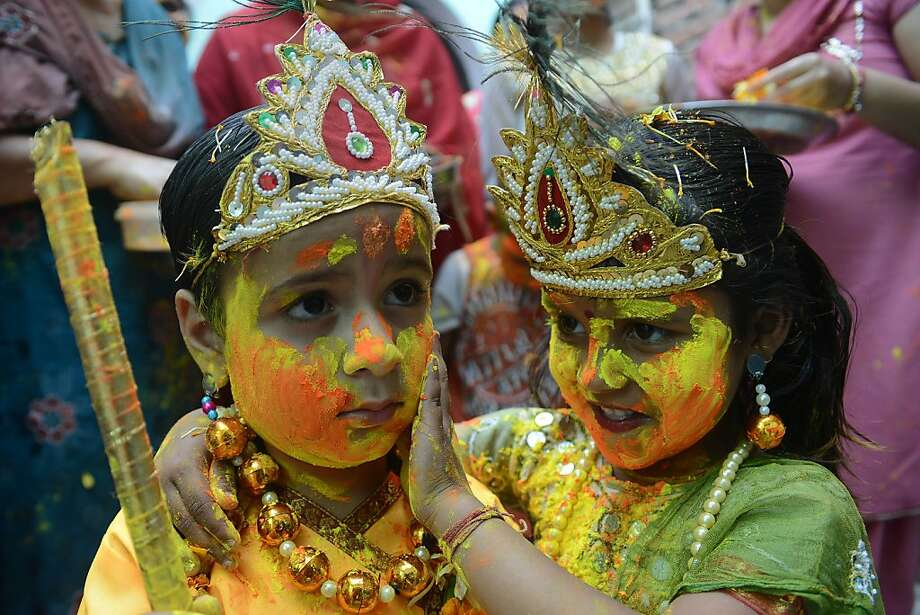 More makeup? Whatever you say, dear:An Indian girl dressed as goddess Radha applies colored powder to the cheek of a young henpecked Lord Krishna during a Holi celebration at a temple in Amritsar, India. Photo: Narinder Nanu, AFP/Getty Images
