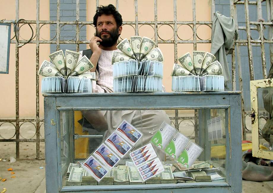 Like most start-ups, it's not making a profit yet: A dollar store in Kandahar, Afghanistan, sells - you guessed it - dollars. A one-dollar bill will cost you approximately $1.00. Photo: Allauddin Khan, Associated Press