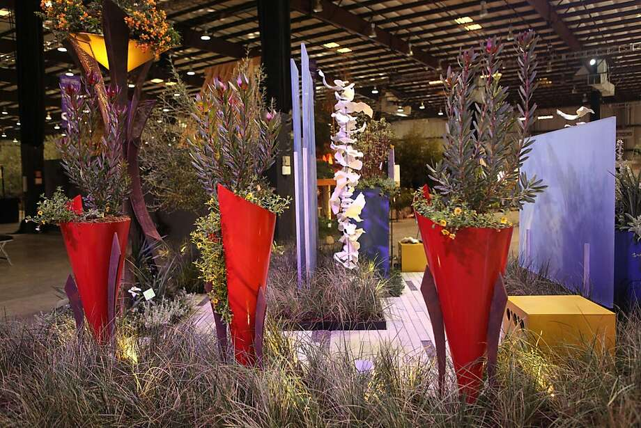 Arterra Landscape Architecture's red, cone-shaped planters are designed to turn heads at the San Francisco Flower and Garden Show. Photo: Liz Hafalia, The Chronicle