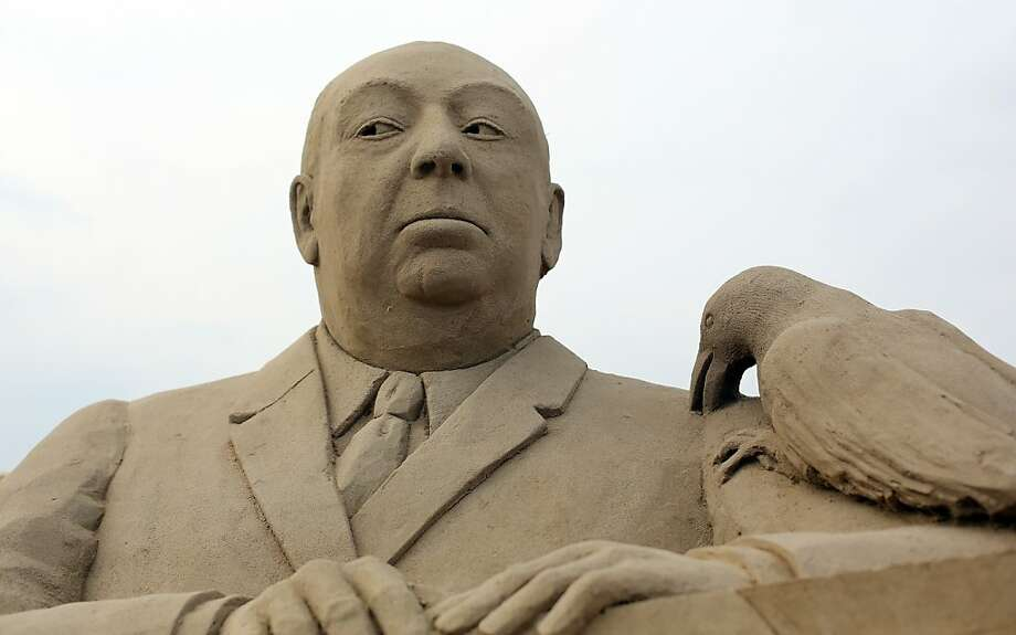 "Gooooood evening ... A sand sculpture of suspense master Alfred Hitchcock pays tribute to his horror film ""The Birds."" Photo: Matt Cardy, Getty Images"
