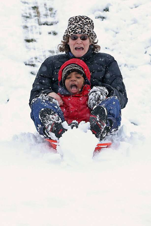 Look, Ma, no brakes!Cathy Eliot and son Matthew speed down a hill on their sled at Takoma Park Middle School in Takoma Park, Md. Photo: Chip Somodevilla, Getty Images