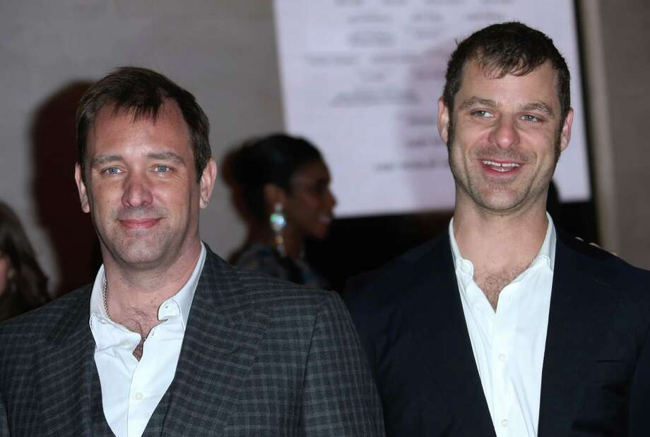 The Book of Mormon creators Trey Parker, left, and Matt Stone pose for photographers on the red carpet as they arrive for the opening night of 'The Book of Mormon' at The Prince of Wales theatre in central London, Thursday, Mar. 21, 2013. (Photo by Joel Ryan/Invision/AP) Photo: Joel Ryan