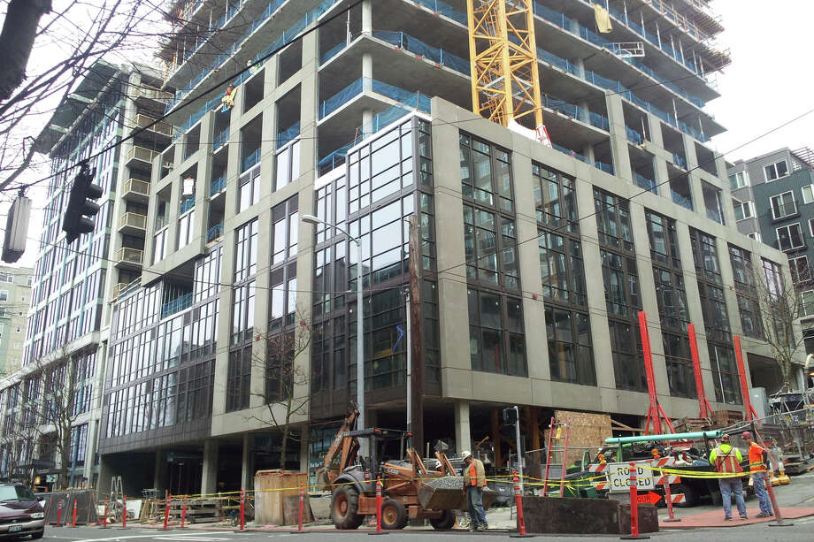 Workers build a new apartment building on March 11, 2013 in Seattle's Belltown neighborhood. Photo: Aubrey Cohen, Seattlepi.com Staff / seattlepi.com