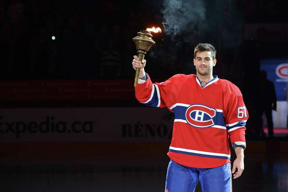 MONTREAL, CANADA - JANUARY 19: Max Pacioretty #67 raises the torch before the NHL opening game between the Montreal Canadiens and the Toronto Maple Leafs on January 19, 2013 at the Bell Centre in Montreal, Quebec, Canada. (Photo by Francois Lacasse/NHLI via Getty Images) Photo: Francois Lacasse, NHLI Via Getty Images / 2013 NHLI