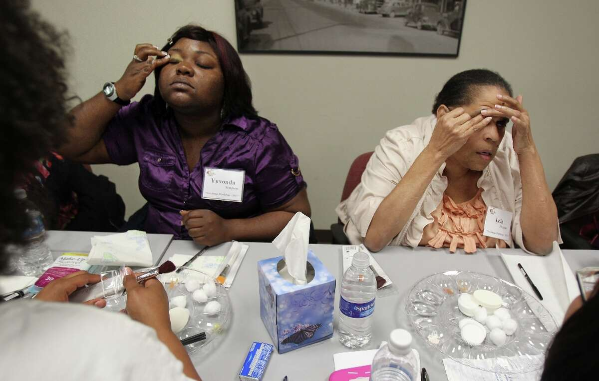 Legally blind makeup consumers Yuvonda Simpson and Lela Pickens apply eye shadow to their eyelids by following their eyebrow bone structure and curves on their faces. The Department of Assistive and Rehabilitative Services held a makeup course for visually-imparied women on Monday, March 25.
