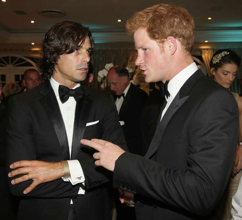 Nacho Figueras chats with Prince Harry as he attends the Sentebale Gala Dinner at Summer Place on Feb. 27, 2013, in Johannesburg, South Africa. Sentebale is a charity founded by Prince Harry and Prince Seeiso of Lesotho. It helps the most vulnerable children in Lesotho get the support they need to lead healthy and productive lives. Prince Harry and Figueras will be opponents during a May 15 polo match in Greenwich to raise money for the Sentebale charity. (Photo by Chris Jackson/Getty Images) Photo: Chris Jackson, Getty Images / 2013 Getty Images