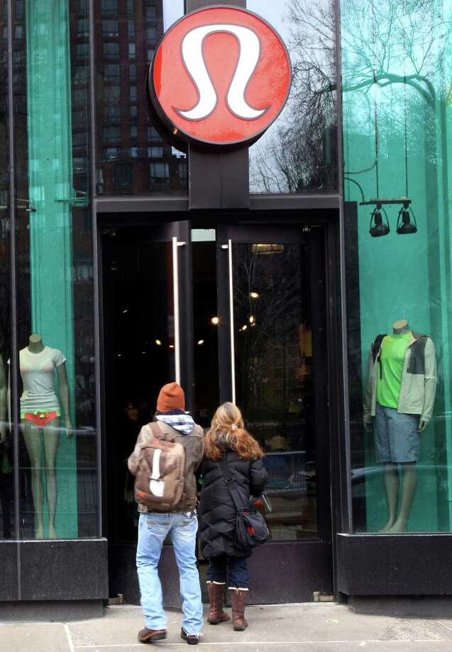 Shoppers enter the Lululemon Athletica store  Tuesday, March 19, 2013 at Union Square in New York. Lululemon has yanked its popular black yoga pants from store shelves after it found that the sheer material used was revealing too much of its loyal customers. (AP Photo/Mary Altaffer) Photo: Mary Altaffer