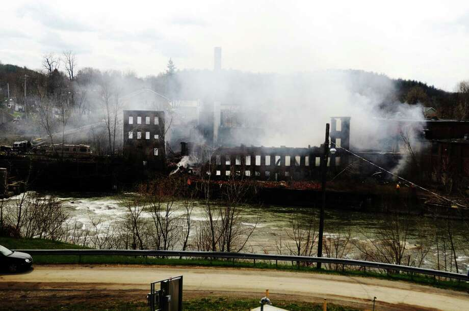 Smoke pours from the James Thompson Mill Wednesday, April 22, 2009, in the town of Valley Falls N.Y. No one was injured in the blaze which destroyed the historic mill. (James Goolsby /Times Union archive) Photo: JAMES GOOLSBY