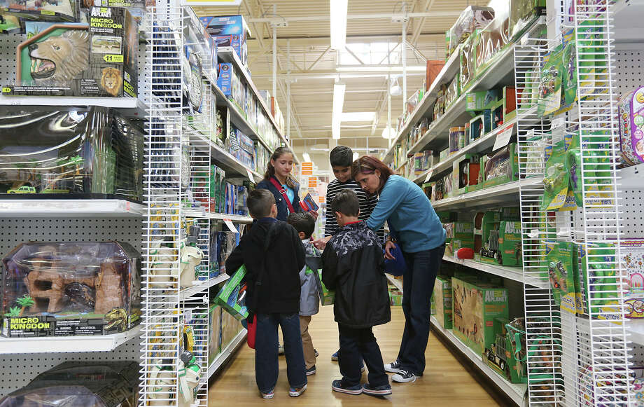 "Elsa Felix (right) leads her children and nephews as they shop at a Toys R Us on Loop 410. Felix, whose family is from San Luis Potosi,  Mexico, said, ""Everything is so much cheaper here."" They also planned to visit SeaWorld, the River Walk and the zoo.