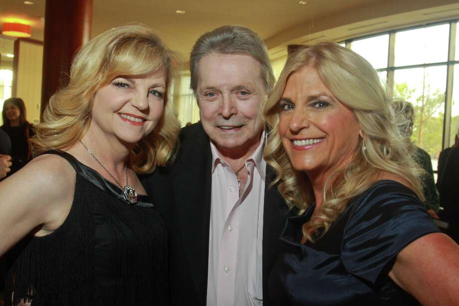 Honoree Mickey Gilley with chairs, Kim Padgett, left, and Vicki Garcia Lehner. Photo: Gary Fountain, For The Chronicle / Copyright 2013 Gary Fountain