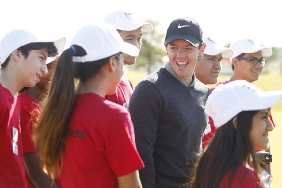 Rory McIlroy visits with students from Chinquapin Prep during a practice round at the Shell Houston Open.