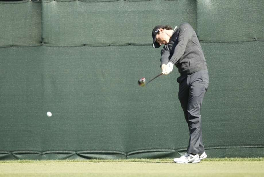 Read: McIlRoy doesn't mind being in the shadow of Tiger Woods.Rory McIlroy tees off on No. 2 during his practice round at the Shell Houston Open.