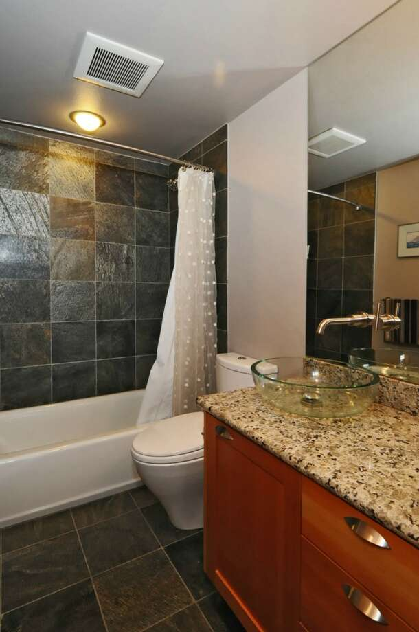 Bathroom of 2610 Marine Ave. S.W., Unit A.The 1,685-square-foot condominium townhouse, built in 2007, has three bedrooms, 3.5 bathrooms, a roof deck, a balcony, a patio and a two-car tandem garage. It's listed for $675,000. Photo: Dan Farmer/Courtesy Terry Miller/Coldwell Banker Bain