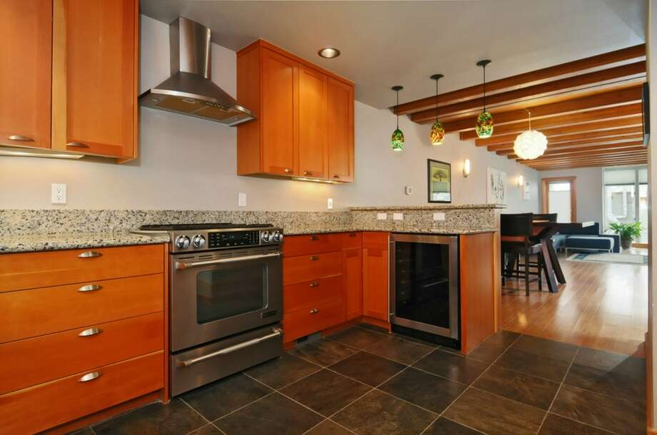Kitchen of 2610 Marine Ave. S.W., Unit A.The 1,685-square-foot condominium townhouse, built in 2007, has three bedrooms, 3.5 bathrooms, a roof deck, a balcony, a patio and a two-car tandem garage. It's listed for $675,000. Photo: Dan Farmer/Courtesy Terry Miller/Coldwell Banker Bain