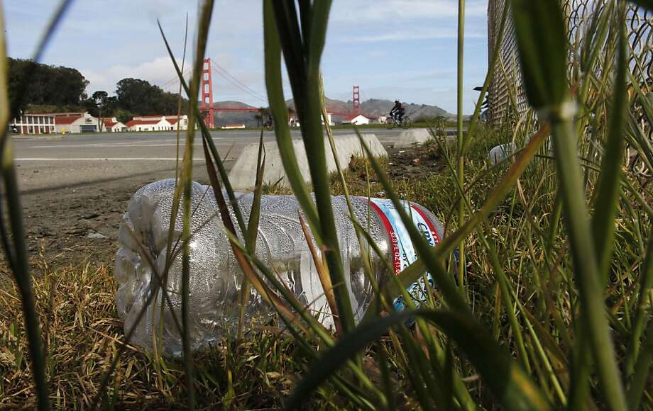 A plastic water bottle was thrown away in the grass at Crissy Field. Some groups estimate that on average, 1,500 water bottles are used in the U.S. every second. Photo: Michael Macor, The Chronicle