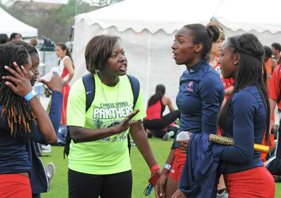Cy Spring girls track and field coach Raqayya Gibson (center) talks with her Lady Panthers 400-meter relay team of sophomores Kelsey Monroe, from left, and Trameceia Sample, junior Tyra Blake and freshman Samiyah Samuels at the Rice University Victor Lopez Relays. The foursome took top honors at the Rice event. Photo: L. Scott Hainline / Freelance